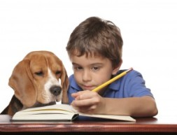 dog-boy-reading-300x230